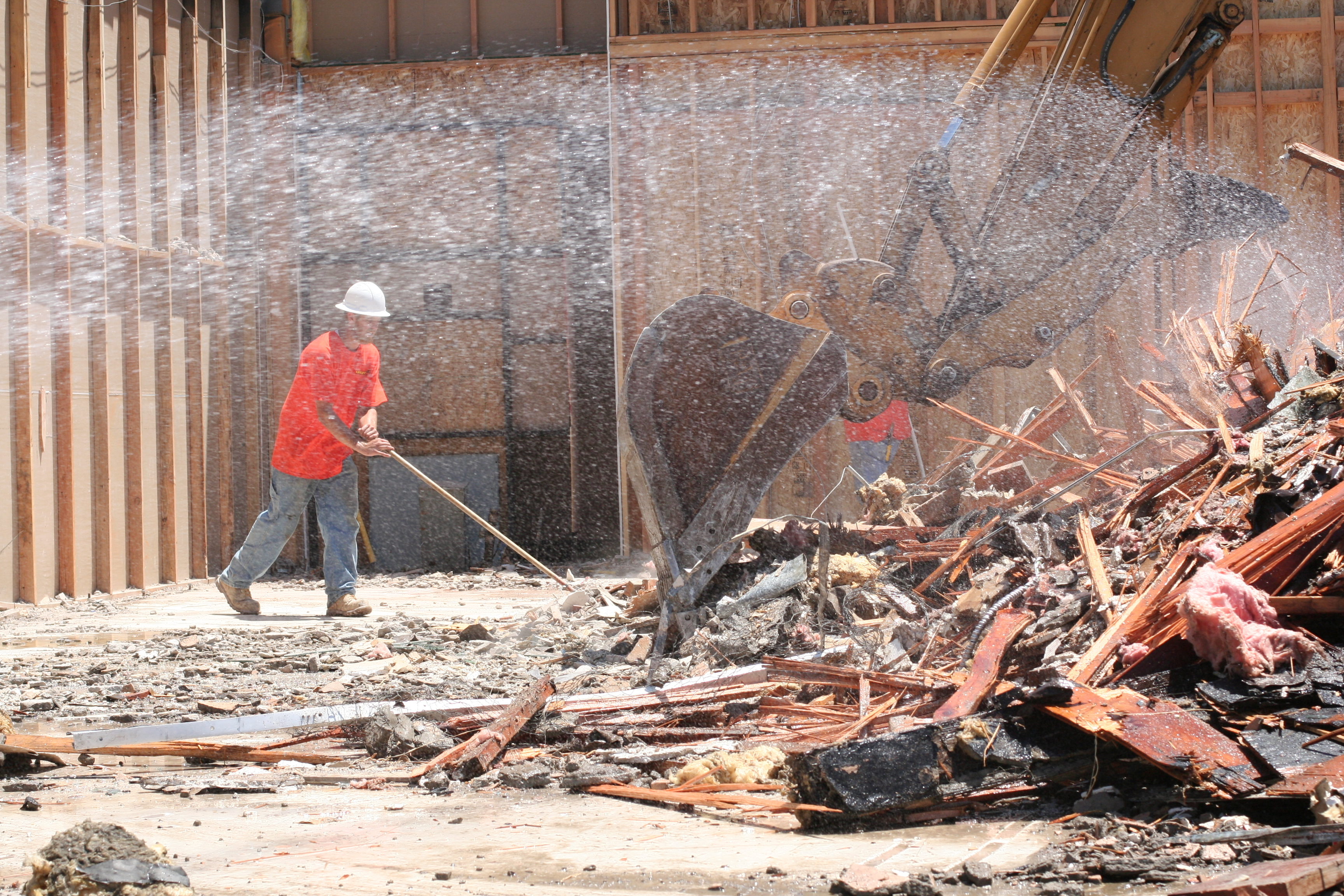 construction-laborer-sweeping-5996602